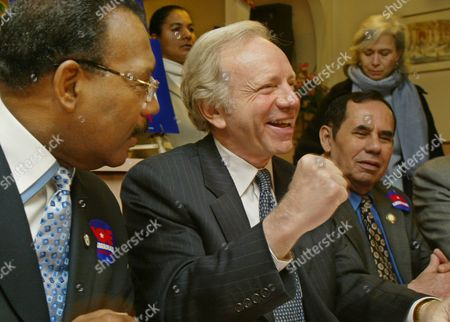 Stock Photo of LIEBERMAN DIAZ TORRES Democratic Presidential candidate Joe Lieberman, center, addresses diners during a visit to Yolanda's Restaurant in the Bronx borough of New York, as New York State Senator Ruben Diaz, left, and Reverend Dr. Andy Torres, right, look, . Lieberman, who picked up an endorsement from Diaz, addressed local clergymembers and other activists over breakfast on his 'Valuing Families Agenda