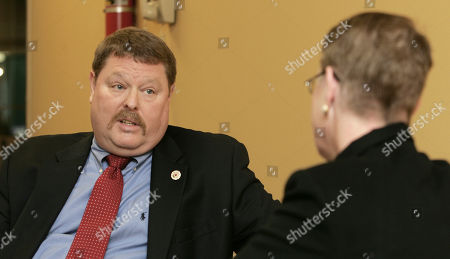 David Lang, president of a firefighters union, questions Maura Carroll interim director of the New Hampshire Local Government Center as they disagree in Manchester, N.H. over how the nonprofit manages health insurance for state employees