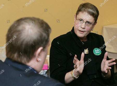 Maura Carroll interim director of the New Hampshire Local Government Center talks with David Lang, president of a firefighters union as they disagree in Manchester, N.H. over how the nonprofit manages health insurance for state employees