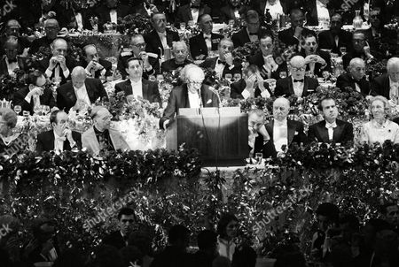 Charles H. Silver, Vice President of the Smith Foundation, addresses the annual Alfred E. Smith memorial dinner as Vice President Hubert H. Humphrey, far left in front row, President Lyndon B. Johnson, immediately right of podium, and Richard M. Nixon, far right in front row, shared a dinner table on . At left by podium is New York Archbishop Terence J. Cooke, and second from right is James A. Farley, former postmaster central at New York's Waldorf Astoria Hotel