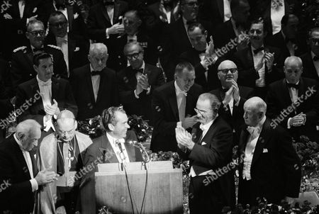 President Lyndon B. Johnson applauds Republican Presidential candidate Richard Nixon, center, after he was introduced as the next speaker at the Alfred E. Smith memorial dinner at the Waldorf Astoria Hotel on Oct.16,1968 in New York. The dinner is billed as nonpolitical. Standing behind Nixon is New York Archbishop Terence J. Cooke. At right, beside Johnson is James Farley, former Postmaster General and speaker at this year's dinner