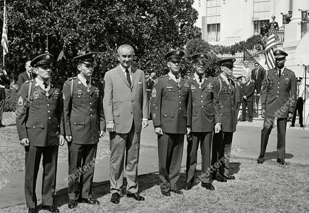 Stock Picture of Five Army enlisted men pose with President Lyndon Johnson after being awarded the nation's highest military award at the White House on . These men are being awarded the Medal of Honor in outdoor ceremonies on the south lawn. The five Army enlisted men, from left: Staff Sgt. Kenneth E. Stumpf of Menasha, Wis.; Sgt. Leonard B. Keller of Rockford, Ill.; 1st Sgt. David H. McNerney of Ft. Dix, N.J,; Staff Sgt. Delbert O. Jennings of Stockton, California an Spec. 4 Raymond R. Wright of Mineville, N.Y. They were honored for heroism in Vietnam