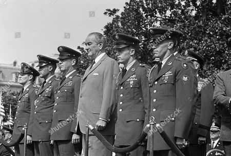 Five Army enlisted men pose with President Lyndon to receive the nation's highest military award at the White House on . in Washington. These men are being awarded the Medal of Honor in outdoor ceremonies. The five Army enlisted men, from left: Staff Sgt. Kenneth E. Stumpf of Menasha, Wis.; Sgt. Leonard B. Keller of Rockford, Ill.; 1st Sgt. David H. McNerney of Ft. Dix, N.J,; Staff Sgt. Delbert O. Jennings of Stockton, California an Spec. 4 Raymond R. Wright of Mineville, N.Y. They were honored for heroism in Vietnam