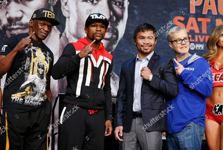 Floyd Mayweather Jr., Manny Pacquiao, Floyd Mayweather Sr., Freddie Roach Floyd Mayweather Sr., from left, Floyd Mayweather Jr., Manny Pacquiao and Freddie Roach pose for photographers during a news conference, in Las Vegas. Mayweather Jr. will face Pacquiao in a welterweight boxing match in Las Vegas on May 2