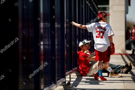 Jack Lewis, 12, of Arlington, Va., right, waits for the stadium to open at the center field gate before a baseball game between the Washington Nationals and the New York Mets on opening day at Nationals Park, in Washington