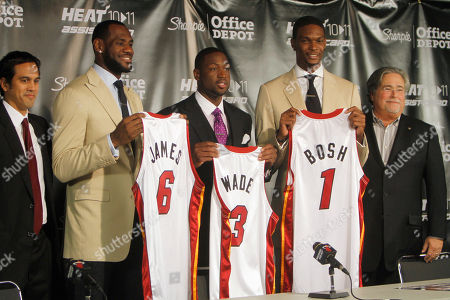 LeBron James, Chris Bosh, Dwyane Wade From left, Miami Heat head coach Erik Spoelstra, LeBron James (6), Dwyane Wade (3), Chris Bosh (1) and owner Micky Arison attend a news conference at the American Airlines Arena in Miami on