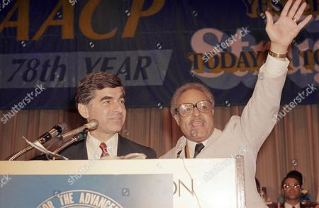Michael Dukakis Democratic presidential contender Michael Dukakis, left, and Benjamin Hooks, executive director of the National Association for the Advancement of Colored People, address delegates at a meeting of the NAACP on in New York. Massachusetts Governor Dukakis criticized President Reagan?s nomination of staunchly conservative Robert H. Bork to the Supreme Court during the meeting