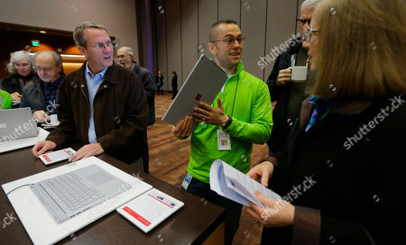 Brad Davis Brad Davis, center, demonstrates a Microsoft Surface Book to guests, at Microsoft's annual shareholders meeting in Bellevue, Wash