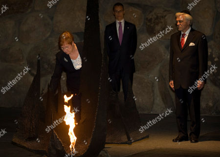 Tarja Halonen, Pentti Arajarvi Finnish President Tarja Halonen rekindles the Eternal flame, as her husband Pentti Arajarvi stands next to her, at the Hall of Remembrance at the Yad Vashem Holocaust memorial, in Jerusalem, . Halonen is on an official visit to the region