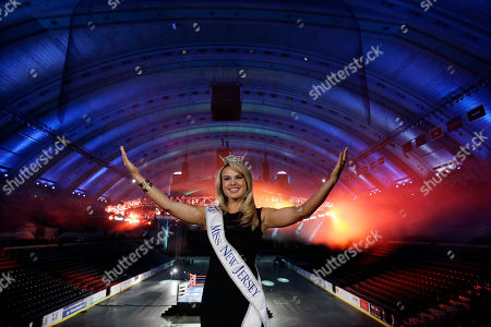 Stock Photo of Lindsey Petrosh Miss New Jersey for 2012 in the Miss America pageant, Lindsey Petrosh, of Egg Harbor City, N.J., gestures for photographs in Atlantic City's Boardwalk Hall, in Atlantic City, after New Jersey Lt. Gov. Kim Guadagno announced that the Miss America pageant is returning to Atlantic City. The pageant returns to Atlantic City in September after spending six years in Las Vegas
