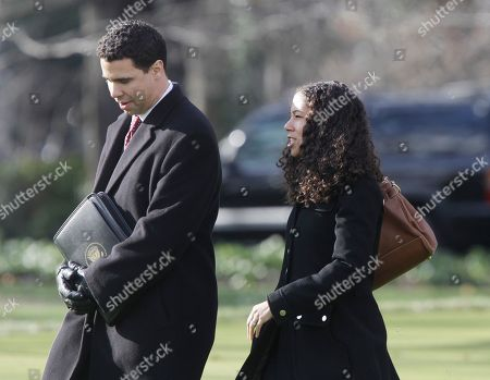 Stock Photo of Mona Sutphen, Bill Burton Deputy Chief of Staff Mona Sutphen, right, walks with Deputy Press Secretary Bill Burton across the South Lawn of the White House in Washington as they accompany President Barack Obama to Winston-Salem, North Carolina