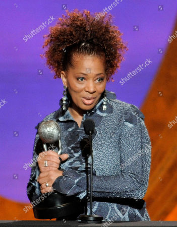 """Terry McMillan Terry McMillan accepts the award for outstanding literary work, fiction, for """"Getting to Happy"""" at the 42nd NAACP Image Awards, in Los Angeles"""