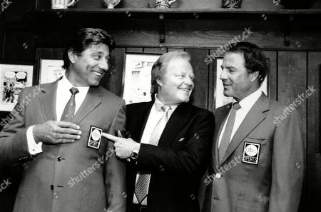 """Namath Arledge Gifford Joe Namath, left, Roone Arledge, pointing to Namath's sports coat logo, and Frank Gifford pose at a news conference at the """"21 Club"""" in Manhattan on . Arledge, who is President of ABC News and Sports, announced that Namath will join the crew of """"Monday Night Football"""