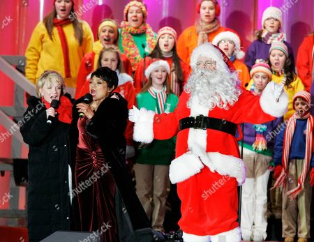 Cathy Rigby, Eartha Kitt, Brad Oscar Cathy Rigby, left, Eartha Kitt, right, and Brad Oscar dressed as Santa Claus, center, perform during the National Christmas Tree lighting ceremony at the Ellipse, in Washington. The lighting of the National Christmas Tree is an unbroken tradition which begun in 1923, when President Calvin Coolidge lit the first tree in the President's Park on behalf of all Americans