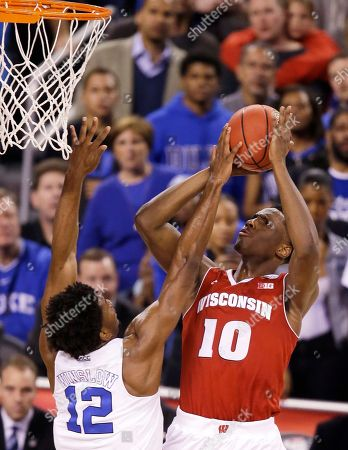 Wisconsin's Nigel Hayes (10) shoots over Duke's Justise Winslow (12) during the first half of the NCAA Final Four college basketball tournament championship game, in Indianapolis