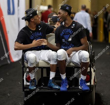 Duke's Quinn Cook and Amile Jefferson get a ride to the news conference after the NCAA Final Four college basketball tournament championship game against Wisconsin, in Indianapolis. Duke won 68-63