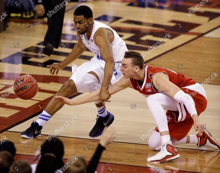 Duke's Matt Jones, left, and Wisconsin's Sam Dekker battle for a loose ball during the second half of the NCAA Final Four college basketball tournament championship game, in Indianapolis