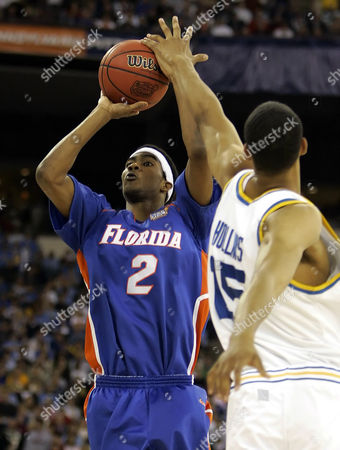 Corey Brewer, Ryan Hollins Florida's Corey Brewer, left, shoots over Florida's Ryan Hollins during their Final Four championship basketball game in Indianapolis