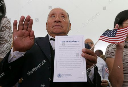 Rodolfo David Miranda, of Peru, takes the Oath of Allegiance at a naturalization ceremony at the Benjamin Harrison Presidential Site in Indianapolis, . Judge Sarah Evans Barker naturalized 101 new citizens at the ceremony