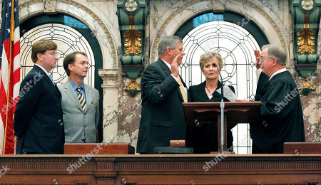 George Carlson Jr., Russell Jolly, Tate Reeves, Billy Hewes, Rhonda Jolly Sen. Russell Jolly, D-Houston, center, recites the oath of office as state Supreme Court Presiding Justice George Carlson, Jr., right, conducts the oath, in Senate Chambers at the Capitol in Jackson, Miss. Among those witnessing the ceremony were, from left, Lt. Gov.-elect Tate Reeves, current President Pro-Tem Billy Hewes, R-Gulfport, and Jolly's wife Rhonda. Jolly fills the remainder of the term of the Sen. Jack Gordon, D-Okolona, who died on May 7, 2011