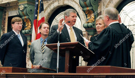 Russell Jolly, George Carlson, Jr., Billy Hewes, Tate Reeves, Rhonda Jolly Sen. Russell Jolly, D-Houston, center, recites the oath of office as state Supreme Court Presiding Justice George Carlson Jr., right, conducts the oath, in Senate Chambers at the Capitol in Jackson, Miss. Among those witnessing the ceremony were Lt. Gov.-elect Tate Reeves, left, current President Pro-Tem Billy Hewes, R-Gulfport, second from left and Jolly's wife Rhonda. Jolly fills the remainder of the term of the Sen. Jack Gordon, D-Okolona, who died on May 7, 2011