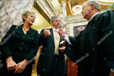 Russell Jolly, Rhonda Jolly, George Carlson Sen. Russell Jolly, D-Houston, center and his wife Rhonda Jolly confer with state Supreme Court Presiding Justice George Carlson Jr., right, who conducted the oath of office, in Senate Chambers at the Capitol in Jackson, Miss. Jolly fills the remainder of the term of the Sen. Jack Gordon, D-Okolona, who died on May 7, 2011