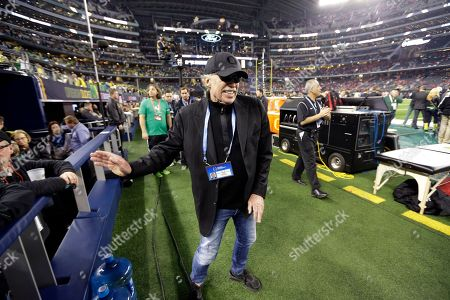Phil Knight Nike Chairman Phil Knight walks near the field before the NCAA college football playoff championship game between Ohio State and Oregon in Arlington, Texas. Knight plans to step down and says he wants Nike President and CEO Mark Parker to succeed him