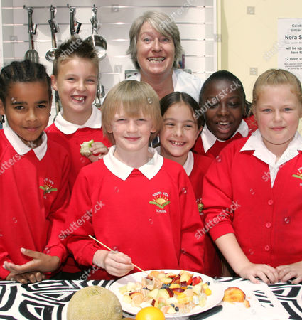 Stock Photo of Nora Sands with children from Southview Junior School