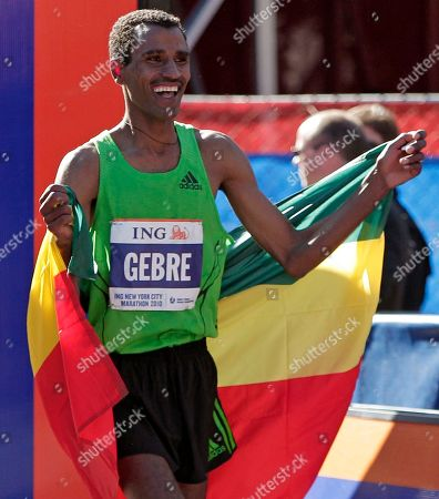 Gebre Gebremariam New York City men's division marathon winner Gebre Gebremariam, of Ethiopia, parades past the finish line wearing his country's flag after winning the New York City Marathon in New York