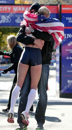 Shalane Flanagan Shalane Flanagan of the United States is hugged by her husband Steve Edwards after Flanagan came in second in the professional women's division at the New York City marathon in New York