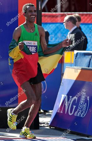 Gebre Gebremariam Gebre Gebremariam, of Ethiopia, parades past the finish line wearing his country's flag after his victory in the men's division at the New York City Marathon in New York