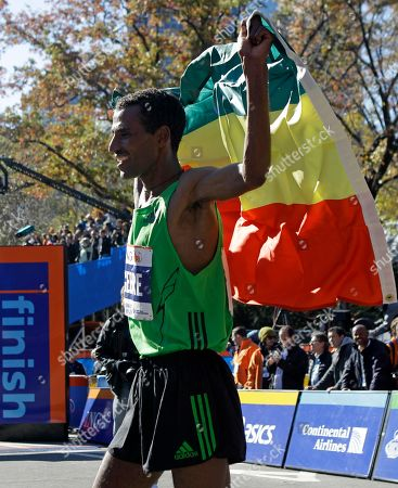 Gebre Gebremariam Gebre Gebremariam of Ethiopia wears his country's flag after winning the professional men's division at the New York City marathon in New York