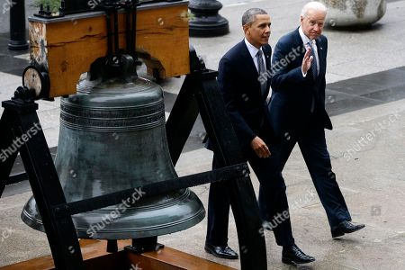 Barack Obama, Joe Biden President Barack Obama and Vice President Joe Biden walk past a reproduction of the Liberty Bell as they arrive at the Treasury Department in Washington, after walking from the White House to the Treasury Department to attend an event for outgoing Treasury Secretary Timothy Geithner