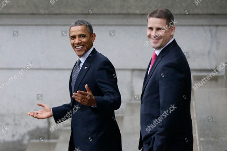 Barack Obama, Dan Pfeiffer President Barack Obama, accompanied by White House Communications Director Dan Pfeiffer, reacts to a reporter's question about the event he was leaving at the Treasury Department in Washington, for outgoing Treasury Secretary Timothy Geithner