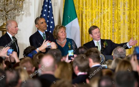 Barack Obama, Enda Kenny, Fionnuala Kenny, Joe Biden Ireland Prime Minister Enda Kenny, right, speaks during a reception in honor of St. Patrick's Day in the East Room of the White House in Washington, with from left Vice President Joe Biden, President Barack Obama, and Kenny's wife Fionnuala Kenny