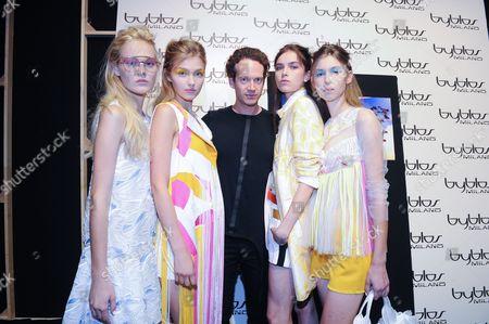 Designer Manuel Facchini and models backstage