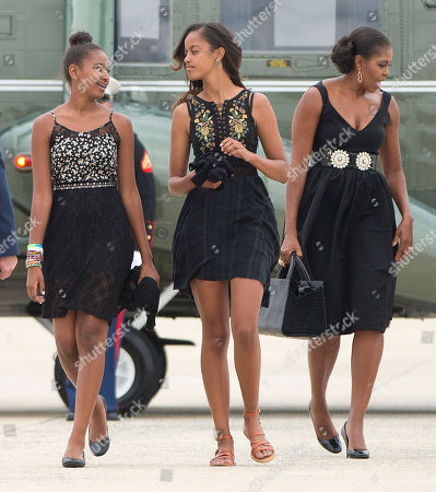 Michelle Obama, Malia Obama, Sasha Obama First lady Michelle Obama, right, and her daughters Sasha, left, and Malia, walk across the tarmac before boarding Air Force One prior to their departure from Andrews Air Force Base, . The first family is traveling to Westchester County, NY., to attend the wedding ceremony of White House chef Sam Kass and MSNBC host Alex Wagner