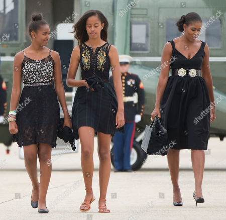 Michelle Obama, Malia Obama, Sasha Obama First lady Michelle Obama, right, and her daughters Sasha, left, and Malia, center, walk across the tarmac before boarding Air Force One prior to their departure from Andrews Air Force Base, . The first family is traveling to Westchester County, NY., to attend the wedding ceremony of White House chef Sam Kass and MSNBC host Alex Wagner