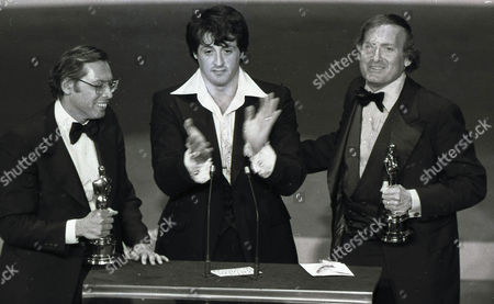 """Stock Image of Rocky"""" co-producers Irwin Winkler, left, and Robert Chartoff, right, flank Sylvester Stallone after receiving Golden Globes at the 34th Annual Golden Globe Awards in Los Angeles. Chartoff, the Oscar-winning movie producer behind the boxing classics """"Rocky"""" and """"Raging bull,"""" has died. He was 81. Lynn Hendee, the president of his company Chartoff Productions, says Chartoff died, at his home in Santa Monica, California. He had been suffering from pancreatic cancer"""