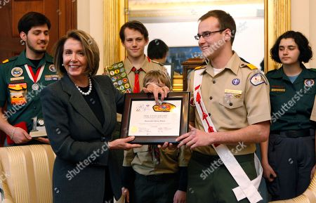 Stock Photo of Edward Myers, Nancy Pelosi, Matthew McGroarty, Colin Byers, Connor Rieve, Brad Lichota, Sabrina Delgado House Speaker Nancy Pelosi of Calif. is presented by Brad Lichota, national chief of the Order of the Arrow, the 100th Anniversary Campership Certificate scholarship certificate from Baltimore (Md.) Area Council at her office on Capitol Hill in Washington, . The Boy Scouts of America presented the Baltimore Area Council a 100th Anniversary Camporee scholarship in honor of Speaker of the House, Nancy Pelosi, which will provide for a Baltimore-area special needs youth to enjoy a Scouting adventure at summer camp in 2010. BSA will also provided scholarships in honor of President Barack Obama, first lady Michelle Obama, and Secretary of Defense Robert Gates. With Lichota are fellow Boy Scouts, from left to right, Matthew McGroarty, of Las Vegas, Nev.; Colin Byers of New York, Edward Myers from Greensboro, N.C.; Lichota and Sabrina Delgado from Phoenix, Ariz