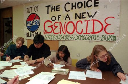 "Stock Photo of SNYDER Penn State ""Students For A Democratic Burma"" from left; Mike Ewall, Ed Mar, Rajika Draviam and Jan Snyder write letters, Saturday, April 6,1996, in State College, Pa., to university president Graham Spanier asking Penn State to issue a statement against investment in Burma and use its stock in Pepsi to support a shareholders' resolution for a human right's code of conduct which will be voted on during a May 1996 stockholders meeting. The group is urging a boycott of Pepsi Co products in hopes to pressure the company to follow others like Amoco, Levi Strauss, Liz Claiborne, Eddie Bauer and Reebok International to stop doing business in the southeast Asian nation"