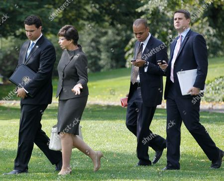 Stock Image of Dan Pfeiffer, Patrick Gaspard, Valerie Jarrett, Bill Burton White House Deputy Press Secretary Dan Pfeiffer, right, walks with political director Patrick Gaspard, second right, senior adviser Valerie Jarrett, second left, and Deputy Press Secretary Bill Burton on the South Lawn of the White House in Washington as they accompany President Barack Obama to Wilmington, Del