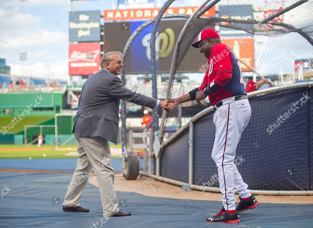 Andrew Bowen MacPhail, Dusty Baker Andrew Bowen MacPhail, left, President of Baseball Operations for the Philadelphia Phillies shakes hands with Washington Nationals manager Dusty Baker, right, on the field prior to the start of a baseball game, in Washington