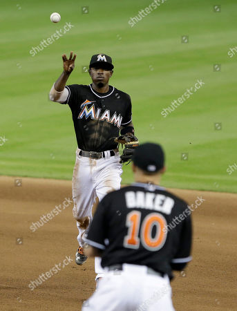 Jeff Baker, Dee Gordon Miami Marlins second baseman Dee Gordon throws to first baseman Jeff Baker (10) to put out Philadelphia Phillies' Grady Sizemore during the seventh inning of a baseball game, in Miami. The Marlins defeated the Phillies 7-0