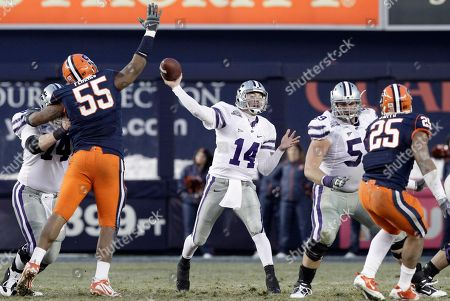 Carspm Coffman, Anthony Perkins Kansas State quarterback Carson Coffman (14) throws under pressure from Syracuse defensive tackle Anthony Perkins (55) during the Pinstripe Bowl NCAA college football game at Yankee Stadium, in New York