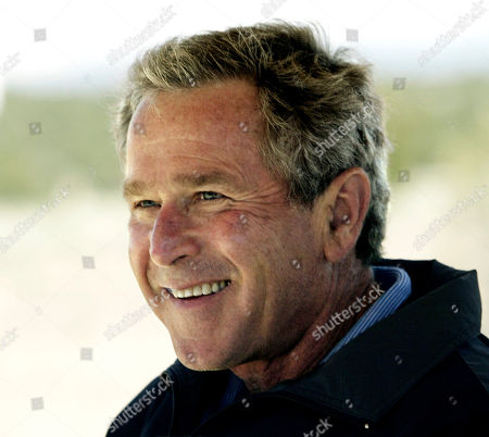BUSH President Bush smiles after a good drive from the first tee at the Las Campanas golf course in Santa Fe, N.M., where he is spending a private weekend with friend Roland Betts