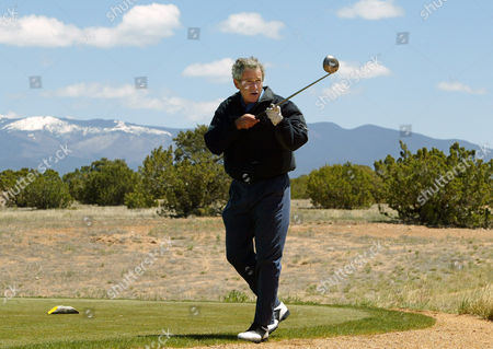 BUSH President Bush admonishes a persistent reporter to bring an end to questions on the Middle East peace process as he prepares to tee off at the Las Campanas course in Santa Fe, N.M., where he is spending a private weekend with friend Roland Betts, . The Sangre de Cristo mountains are in the background