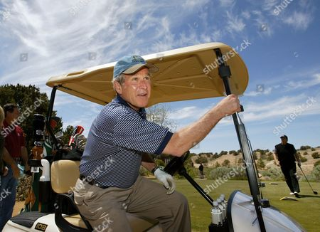 BUSH President Bush smiles after driving from the first tee at the Las Campanas golf course in Santa Fe, N.M., where he is spending a private weekend with friend Roland Betts