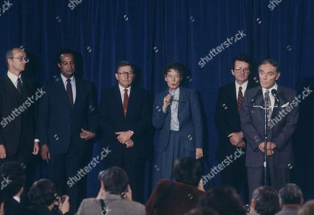 Jeane Kirkpatrick, the first woman chosen by President-elect Ronald Reagan for a Cabinet-level post, gestures as Reagan nominees gather on in Washington for the announcement of selections. From left are: James G. Watt, Interior Secretary-designate; Samuel R. Pierce, Housing and Urban Development secretary-designate; James B. Edwards, Energy secretary-designate; Jeane Kirkpatrick, United Nations ambassador-designate; Raymond Donovan, Labor-secretary-designate; and Alexander Haig, Secretary of State-designate