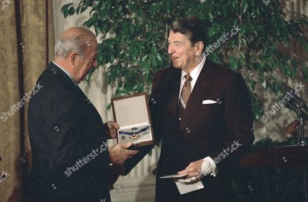 Ronald Reagan, George Shultz President Ronald Reagan presents the Presidential Medal of Freedom to Secretary of State George Shultz at a White House luncheon on . Shultz, along with former U.S. Ambassador Mike Mansfield, received the award, the highest civilian award of the U.S. government